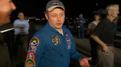 Mission Specialist Mike Fincke, who clocked 382 days in space making him the record-holder American astronaut, talking to the team on the ground as the astronauts walk around Endeavour. NASA 2011.