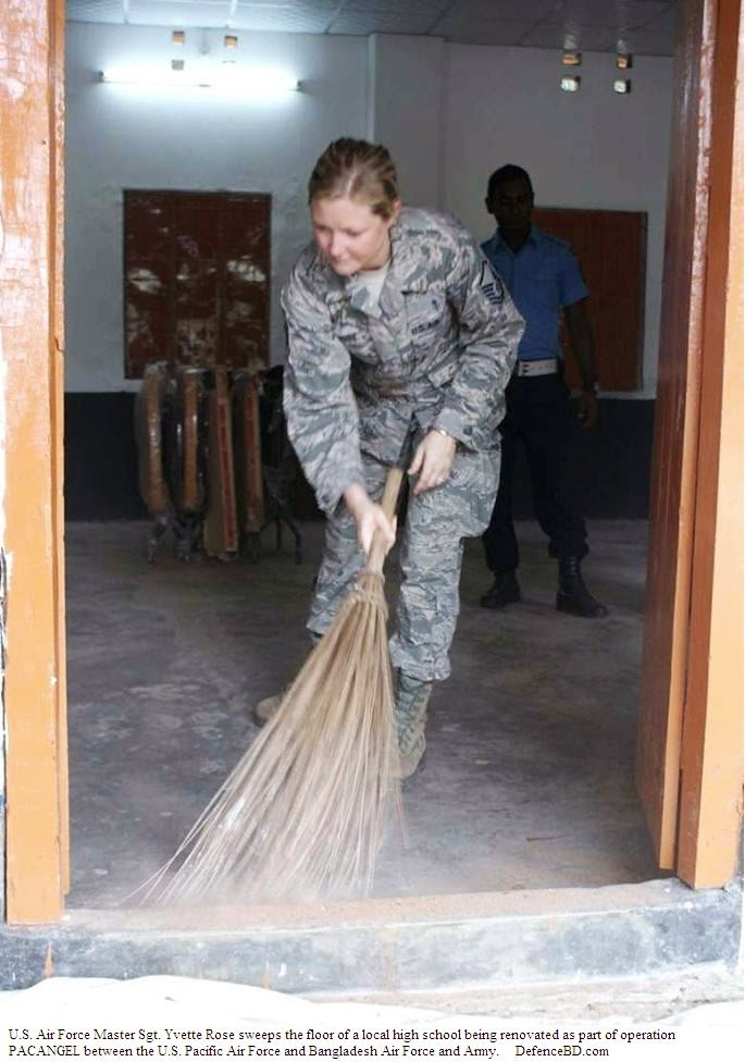 U.S. Air Force Master Sgt. Yvette Rose sweeps the floor of a local high school being renovated as part of operation PACANGEL between the U.S. Pacific Air Force and Bangladesh Air Force and Army.