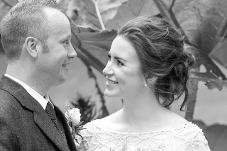 bride with romantic textured hairstyle smiling with her husband