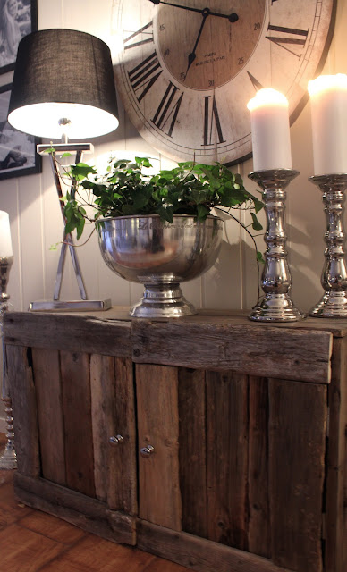 Wood credenza with metal bowl and candlesticks