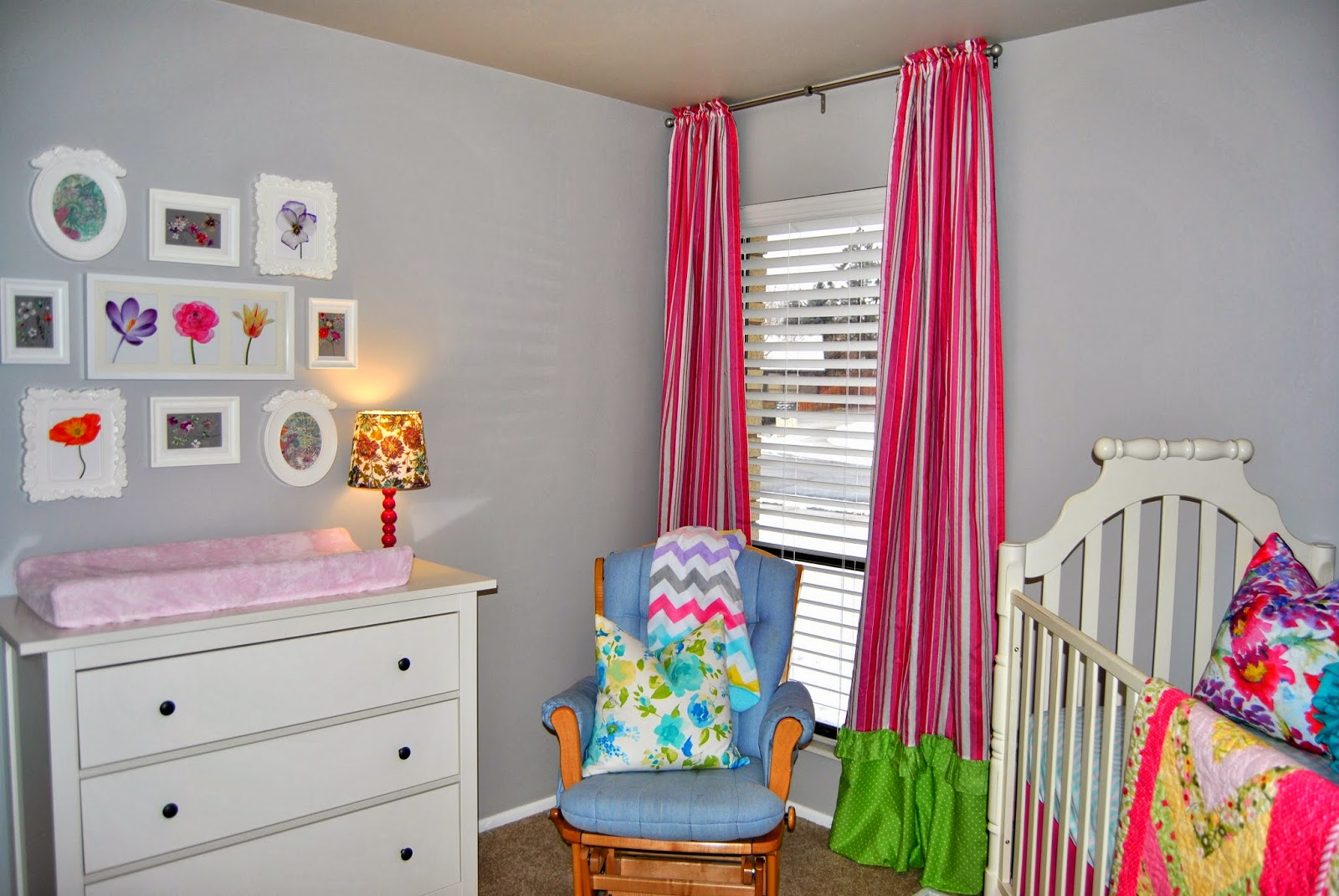 Ikea, wall gallery, blue, pink, turquoise, green, purple, curtains, hot pink curtains, gray walls, seattle, poufs above crib, white furniture, nursery, tjmaxx, throw pillows, studio 7 interior design, hemnes dresser
