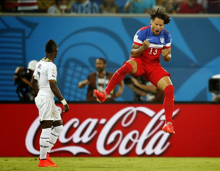 Ghana's Christian Atsu, left, looks back at his net as United States' Jermaine Jones celebrates a goal by Clint Dempsey during the group G World Cup soccer match between Ghana and the United States at the Arena das Dunas in Natal, Brazil, Monday, June 16, 2014.
