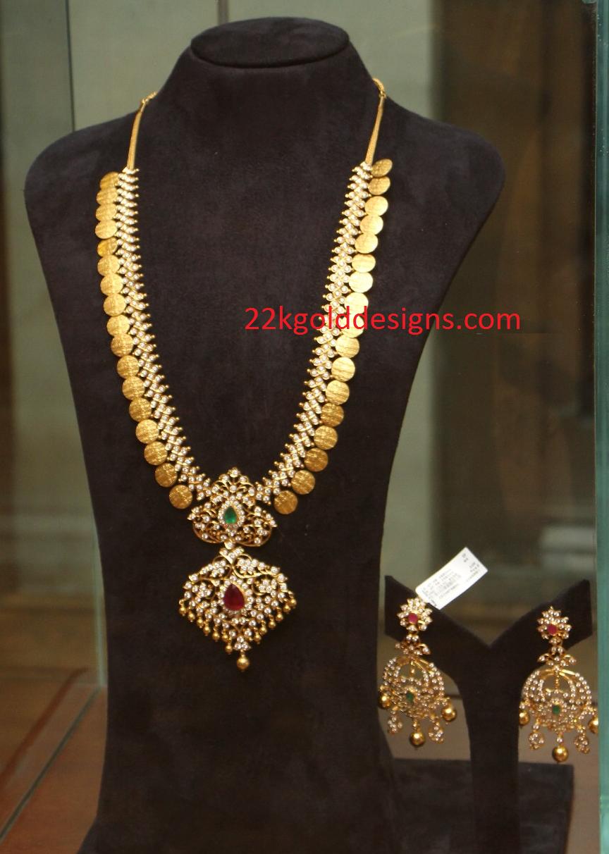 Diamond necklace set by khazana jewellers latest jewellery designs - Diamond Kasulaperu With Pendant