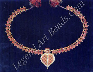 The term for the jewel translates: 'banyan leaf lower waist bell chain', in this example of royal provenance, intended for a girl child, the pendant, in the shape of a banyan leaf, is set with uncut diamonds, the reverse finely-worked in repousse with a Tree of Life motif; the bell-shaped units on either side are encrusted with cabuchon rubies, The sacred banyan tree is associated with longevity, prosperity and good health.