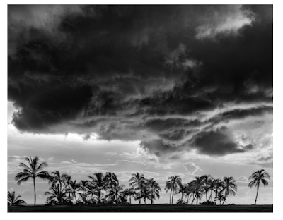 Photograph of a stormy sky, taken in black and white. Hawaiian weather provided the great contrast for this photo.