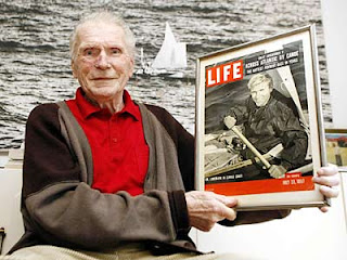 Hannes Lindemann, 84, holds copy of Life magazine featuring his transatlantic kayak voyage