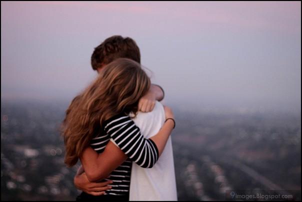 Boy and Girl Hugging Goodbye Photo