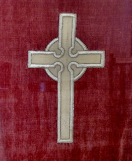 Cross on a banner
