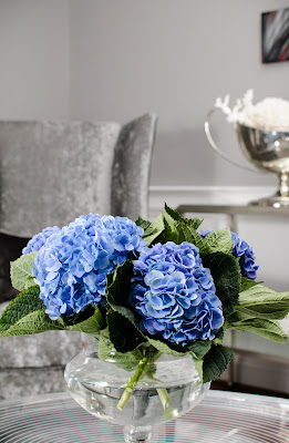 grey;velvet;hydrangea; chair; coffee table; trophy;shells