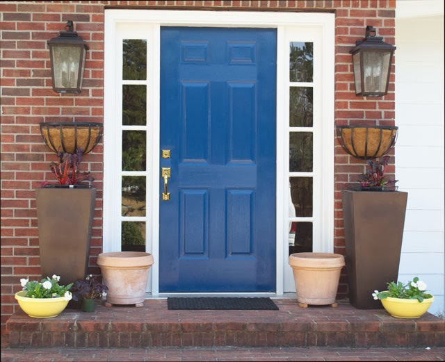 adding colorful planters to the front entry