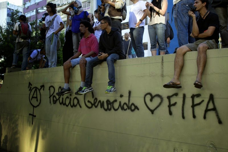 "Graffiti on the walls in Barra da Tijuca in Rio de Janeiro reads, ""Genocidal police loves  FIFA."" 13 July 2014. Photo by Shay Horse. (c) Demotix"