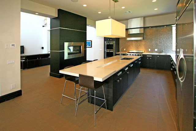 Picture of large modern kitchen with dark furniture