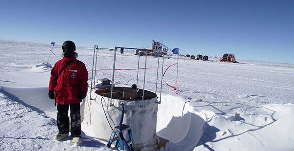 UD's Bakhtiyar Ruzybayev works on an IceTop cosmic ray detector, part of an extensive array at the surface of the IceCube Neutrino Observatory at the South Pole. Credit: udel.edu