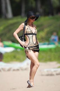 Paris Hilton having fun in a classic bikini with her boy friend in beach.