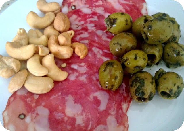 Antipasto - salami, olives and cashew nuts
