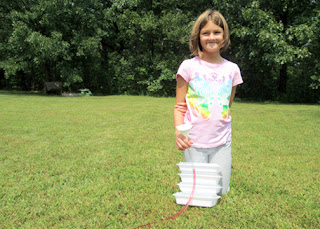 Tessa and I created and tested a water level that we made out of clear plastic tubing, a funnel and colored water. Tessa learned that when water is in a confined space, gravity makes sure the top of it is level. Pretty cool!