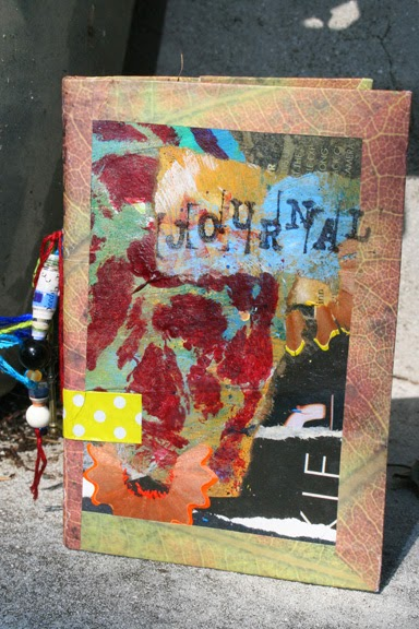 Art Journal of recycled cereal boxes, paper bags and fun. Cover detail.