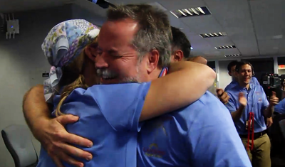 Curiosity MSL lands on Mars. Entry, Descent and Landing (EDL) team in blue shirts. emotional embraces. 6 August 2012. NASA/JPL.