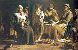 Familia de campesinos en torno al hogar