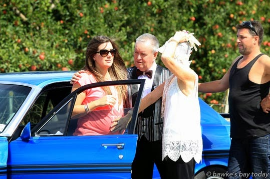 L-R: Amanda Holmes, six months pregnant, her parents David and Heather Holmes (who arrived on the scene from Art Deco weekend in Napier) and Chris Newrick, pictured with their 1971 GT Falcon, which was damaged by falling powerlines. Amanda and Chris were trapped in their car until Unison could turn off the power, after an 80 year-old woman from Palmerston North crashed into a power pole on Pakowhai Rd, near the intersection of Ruahapia Rd, bringing down three poles and breaking a fourth. The woman was taken to Hawke's Bay Hospital. Police, fire service and St John Ambulance attended. photograph