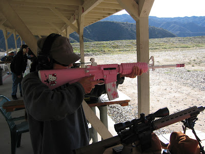 Hello Kitty shooting pink AR-15 rifle gun