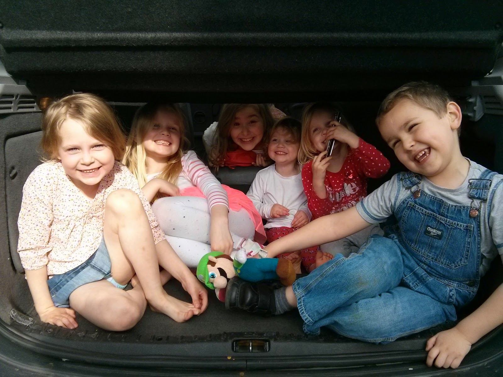 Cousins packed in the boot of the car