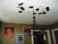 Chandelier with motorcycle mirrors for reflectors