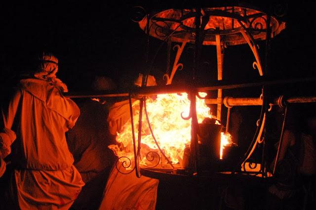 lamplighters carrying flaming lantern at burning man