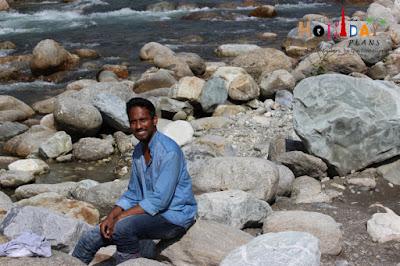 Rahul posing near River