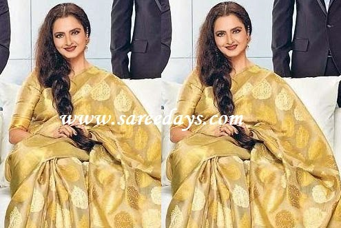 Latest saree designs rekha in beige traditional silk saree checkout bollywood actress rekha in beige traditional silk saree with zari work and paired with matching half sleeves blouse altavistaventures Image collections