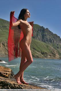 Sasha C on the beach oiled body