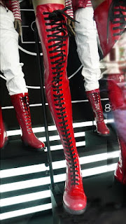 Moncler Red way-over-the-knee, lace-up boots.