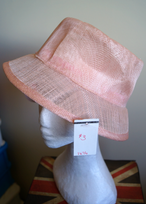 Before photo of pink sinamay hat