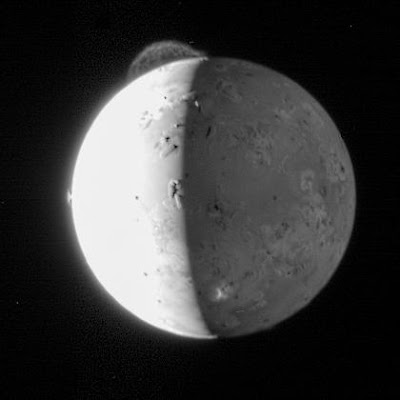 This five-frame sequence of images from NASA's New Horizons mission captures the giant plume from Io's Tvashtar volcano. Snapped by the probe's Long Range Reconnaissance Imager (LORRI) as the spacecraft flew past Jupiter in 2007, this first-ever movie of an Io plume clearly shows motion in the cloud of volcanic debris, which extends 330 km (205 miles) above the moon's surface. Only the upper part of the plume is visible from this vantage point. The plume's source is 130 km (80 miles) below the edge of Io's disk, on the far side of the moon. Io's hyperactive nature is emphasized by the fact that two other volcanic plumes are also visible off the edge of Io's disk: Masubi at the 7 o'clock position, and a very faint plume, possibly from the volcano Zal, at the 10 o'clock position. Jupiter illuminates the night side of Io, and the most prominent feature visible on the disk is the dark horseshoe shape of the volcano Loki, likely an enormous lava lake. Boosaule Mons, which at 18 km (11 miles) is the highest mountain on Io and one of the highest mountains in the solar system, pokes above the edge of the disk on the right side. The five images were obtained over an 8-minute span, with two minutes between frames, from 23:50 to 23:58 Universal Time on 1 March 2007. Io was 3.8 million km (2.4 million miles) from New Horizons. Credit: NASA/Johns Hopkins University Applied Physics Laboratory/Southwest Research Institute