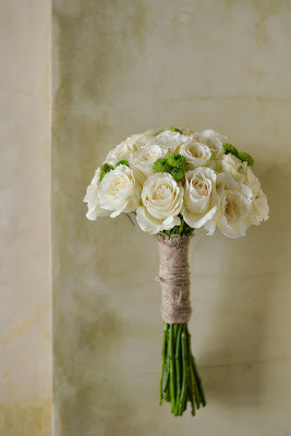 bouquet made from white roses, green spray chrysanthemums, wrapped with burlap and natural string