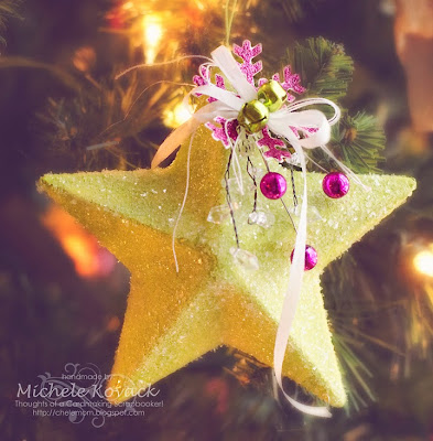 lime green mache star covered in glitter with ribbon, beads and paper snowflake decorations