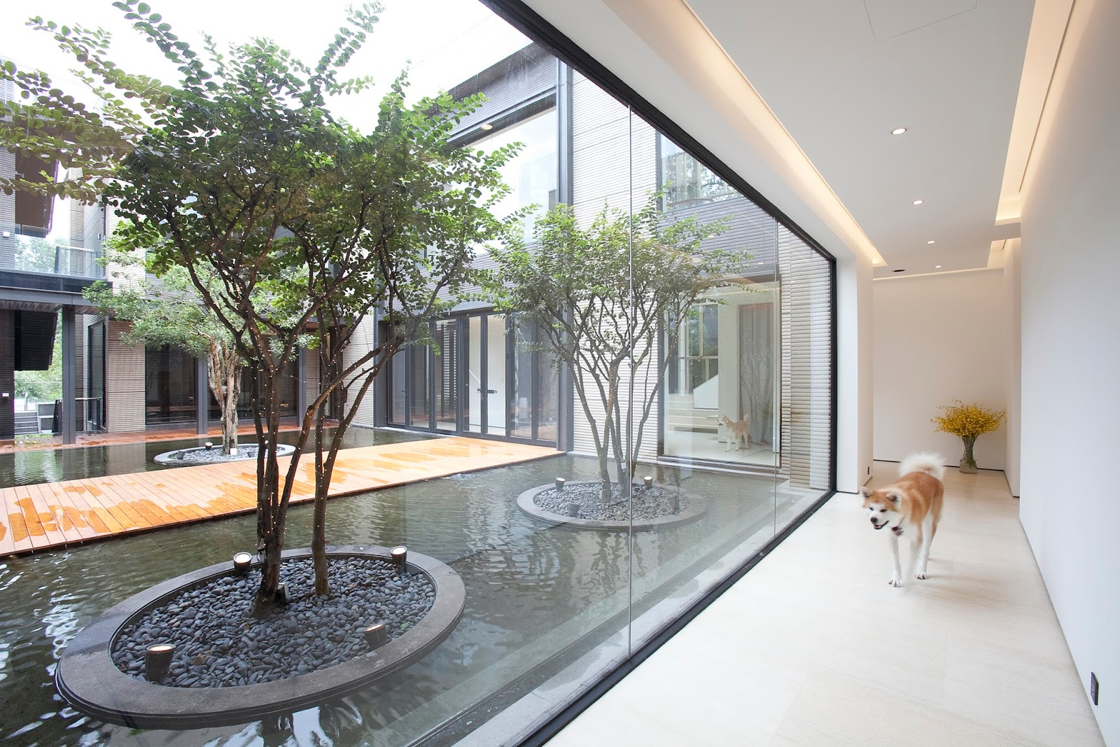 Overlooking A Scenic Golf Course In Huadu District Guangzhou The 15000 Sq Ft Dragon Lake House Embodies Less Is More Design Approach