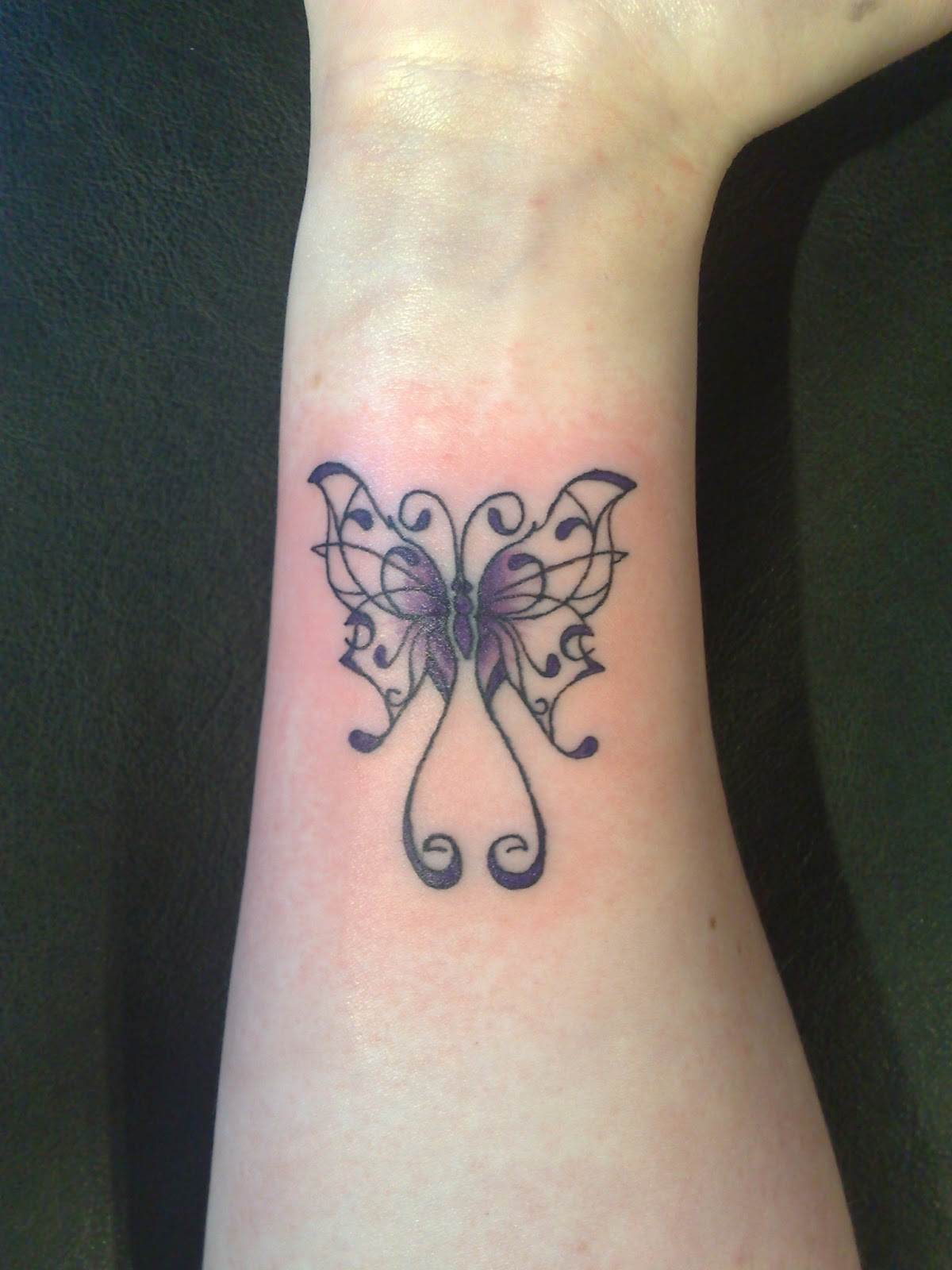 Side tattoos for girls for Butterfly tattoo wrist designs