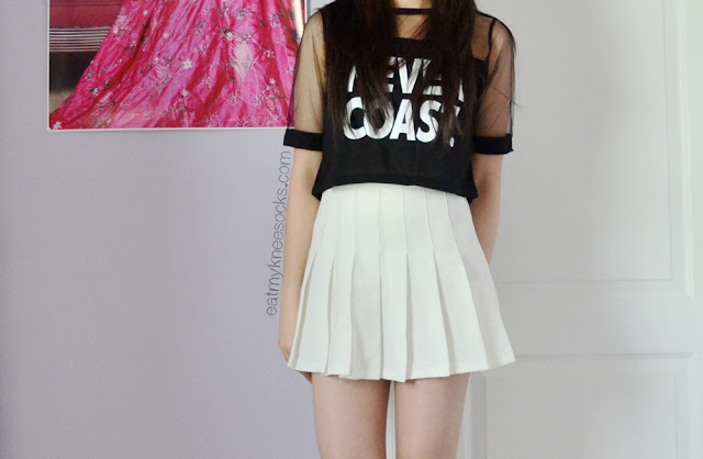 "An ulzzang-inspired outfit featuring the ""Never Coast"" mesh crop top from Dresslink and a white American Apparel pleated tennis skirt."