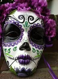 Elaborately painted skull-mask in green and purple designs