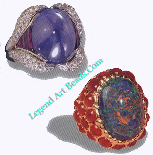 A ring made with a cabochon sapphire, amethyst, and pave diamonds c. 1945. The second ring consists of a black opal and rubies, c. 1950.