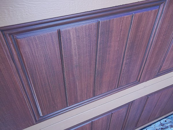 detail of garage door painted to look like wood