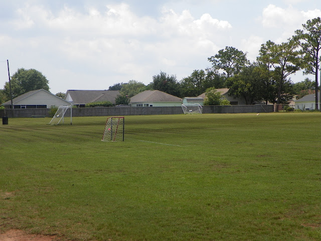 Soccer fields, frisbee golf, & playground at Optimist Park