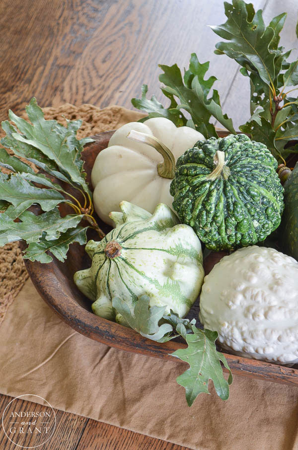 Green and white gourds, squash, pumpkins, and oak leaves...Great idea for a neutral fall decor.