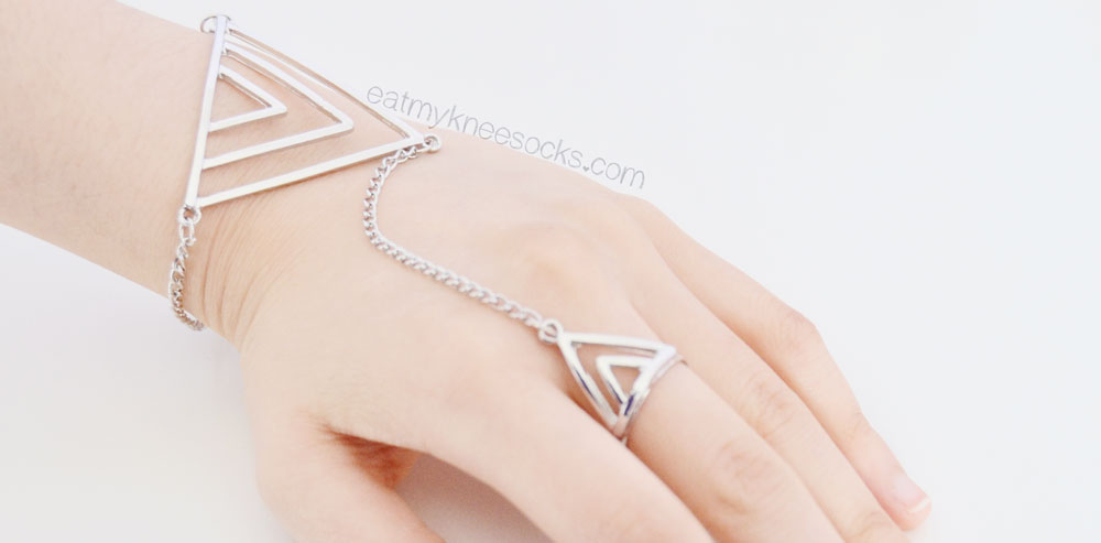 The silver triangle hand chain from Born Pretty Store, as modeled.
