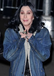 Cher in a denim jacket