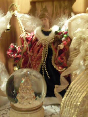 Angels with gold and white Christmas snow ball