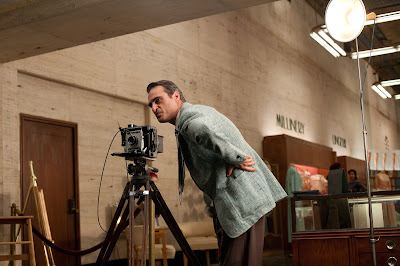 Joaquin Phoenix as Freddie Quell in The Master, takes a still photograph, standing behind the still camera, directed by Paul Thomas Anderson