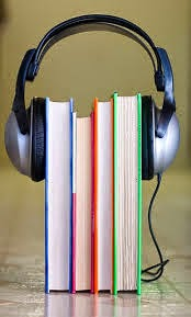 books wrapped in headphones