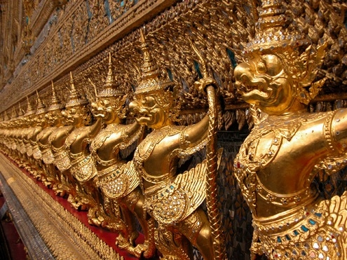 gold carvings statuettes at royal palace Bangkok thailand grand